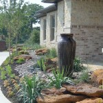 boulder and rock landscaping with disappearing fountain