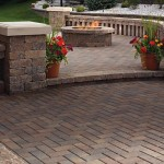 fire pit with holland paver decking and step
