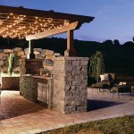 outdoor kitchen pergola and belgard pavers