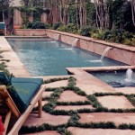 pool with scuppers and flagstone mondo grass decking